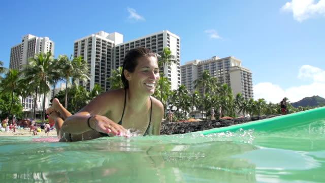 Slow Motion Surfer Girl Paddling On Summer Day video