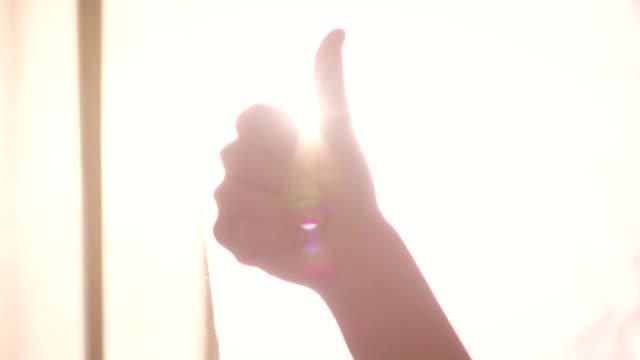 Slow motion: thumb up success symbol video