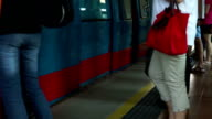 Slow Motion Train door opens when Commuters enters and leaves video