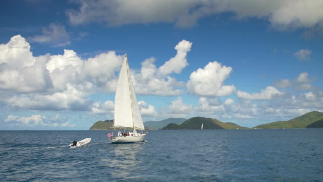 slow motion video of a sloop sailing through the Caribbean video