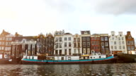 Slow motion video of view from the canal to the streets. video