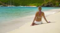 slow motion video of woman sunbathing on a Caribbean beach video