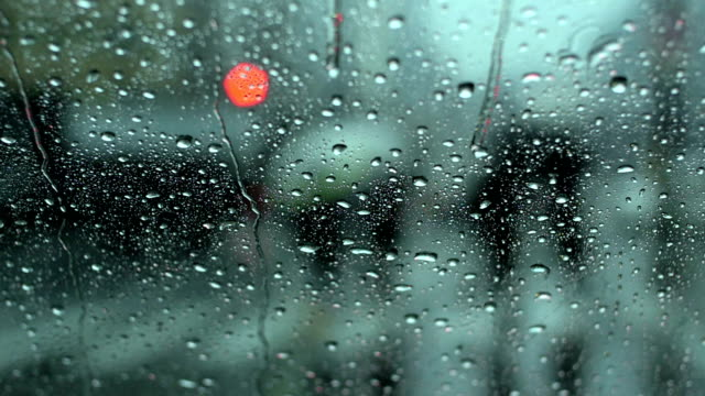 Slow motion view of commuters traveling in heavy rain. video