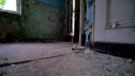 Slow motion walking through a cracked abandoned building video