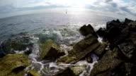 Slow Motion Wave Crashing on Rocks video
