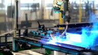 HD Slow Motion: Welding Robot movement in automotive assembly factory video
