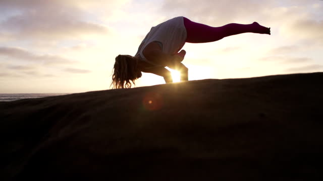 Slow Motion Woman Practicing Yoga Stretching Pose At Sunset with Lens Flare video