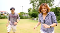Slow motion : Young Couple running in the park video