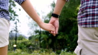 Slow Motion : Young Couple Walking In park video