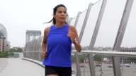 Slow Motion Young Mixed Race Woman Running In Downtown Urban Setting video