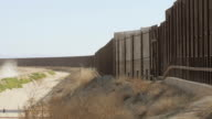 Slow Pan of Border Fence Between the US and Mexico video