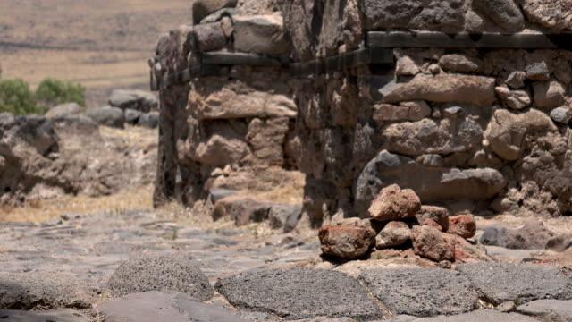 Slow Pan Over Stone Path Leading Into Ruined City video