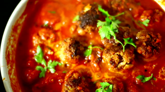 Slow simmering meatball and sauce meal. video