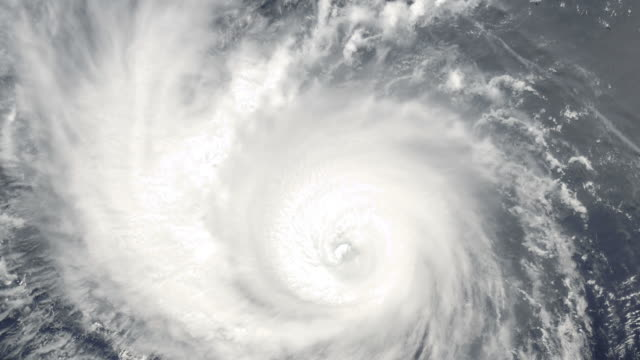 Slowly rotating cyclone viewed from space video