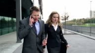 STEADYCAM Slow-Mo: Business Couple Disputing On Phone While Leaving. video