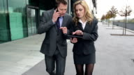 STEADYCAM Slow-Mo: Business Team Checks Tablet While Talking On Phone. video