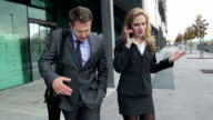 STEADYCAM Slow-Mo: Dissatisfied Business Couple Argues On Phone. video