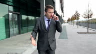 STEADYCAM Slow-Mo: Dissatisfied Businessman Argues On Phone. video