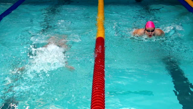 HD Slow-Mo: Female swimmer winning on the competition video