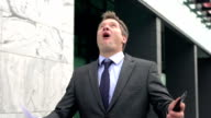 Slow-Mo: Satisfied Businessman On Phone Throws Papers In The Air. video