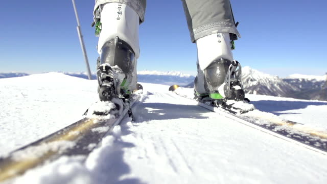Slow-Mo. Ski Boots Being Attached To Carving Skis video