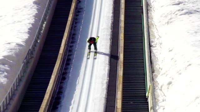 HD Slow-Mo: Young Man Performing Ski Jump video