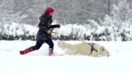 Slow-Mo: Young Woman Running With Her White Swiss Shepherd Dog video