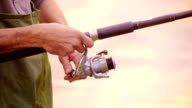 Slow-Mo:Fisherman pulls the fishing line on reel video