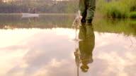 Slow-Mo:Fisherman reflection at Sunset video
