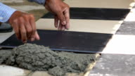 slow-motion, construction worker tiling ceramic tiles floor video