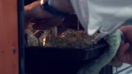 Slowmotion. Cook put the pan with the meat in the oven video