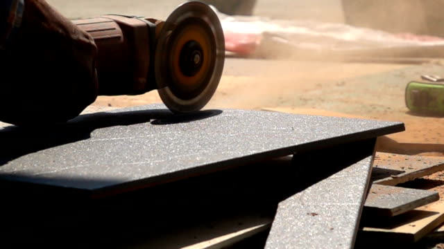 Slow-motion, Electric saw cutting tiles floor video