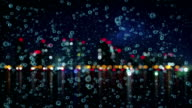 slowmotion rain and blurred night city loopable animation video