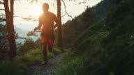 Slow-motion trail running in the forest: off-road run video