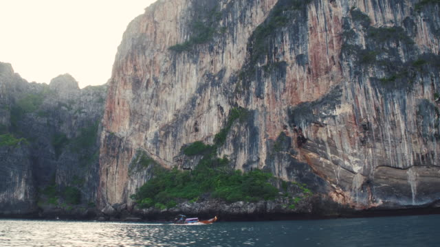 A small boat on the background of the tropical island of phiphi-lei video