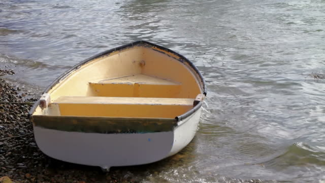 small boat rocking on the shore video