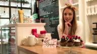 Small business owner behind the counter of her shop video