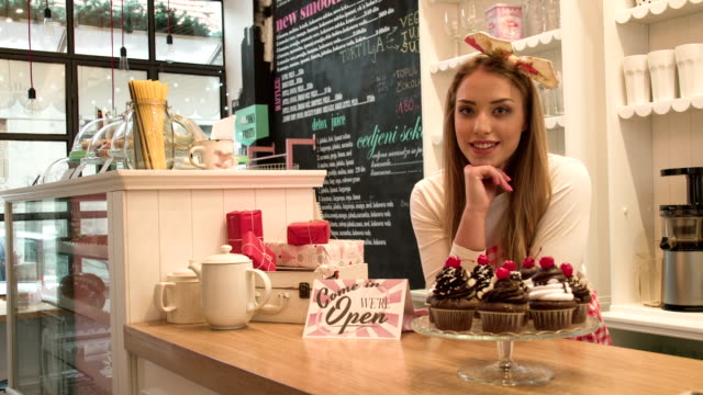 Small business owner in cake and coffee shop video