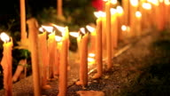 HD: Small candles lit and set on the path near the tree. video