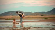 Small child playing in the mud. video