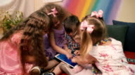 Small children play with the tablet. video