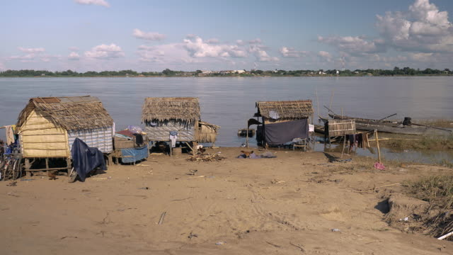 Small fishermen's village on the edge of river video