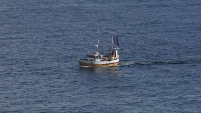 Small fishing boat at sea. video