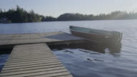 small fishing boat dock in lake ontario summer canada video