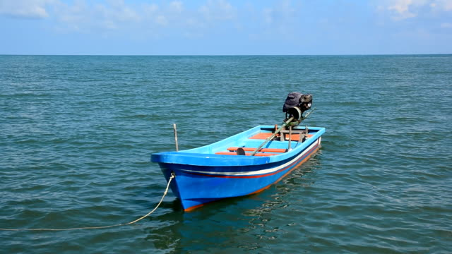 small fishing boat on the sea video