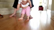 Small girl learning to walk video