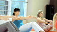 Small Group Doing Pilates Exercises video