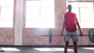 Small group of athletes on crossfit training class at gym video