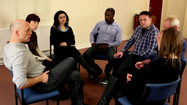 Small Group of people talking, Therapy session, Counselling video
