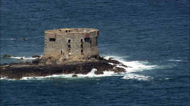 Small island and watchtower - Aerial View - helicopter filming,  aerial video,  cineflex,  establishing shot,  Jersey video